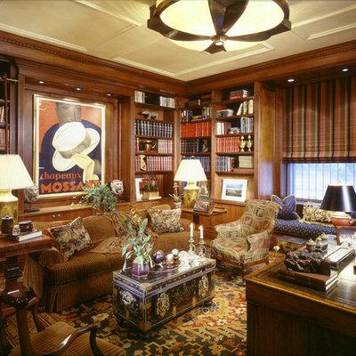 Example of a classic freestanding desk medium tone wood floor home office design in New York