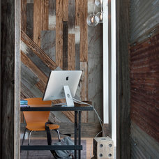 Industrial Home Office by Groundswell Design Group, LLC