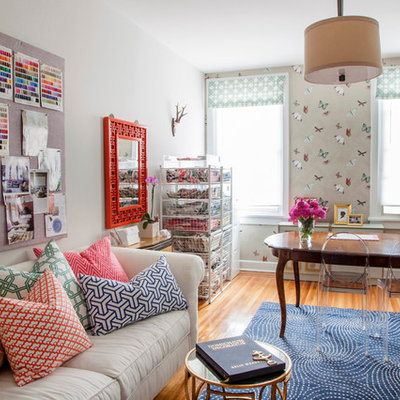 Inspiration for an eclectic freestanding desk medium tone wood floor home office remodel in Philadelphia with white walls