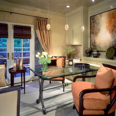 Inspiration for a contemporary freestanding desk carpeted home office remodel in Orange County with beige walls