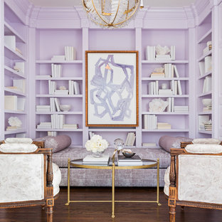 Medium sized contemporary home office and library in Little Rock with a reading nook, purple walls and medium hardwood flooring.