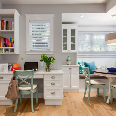Inspiration for a mid-sized transitional built-in desk light wood floor study room remodel in Vancouver with gray walls and no fireplace