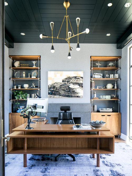 Arbeitszimmer mit kaminsims aus stein und teppichboden for Arbeitszimmer wandfarbe