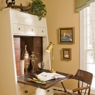 Example of an eclectic freestanding desk medium tone wood floor home office design in Bridgeport with beige walls