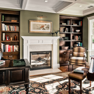 Inspiration for a timeless freestanding desk dark wood floor home office remodel in San Francisco with green walls and a standard fireplace