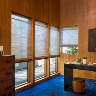 Inspiration for a freestanding desk carpeted home office remodel in Portland with brown walls