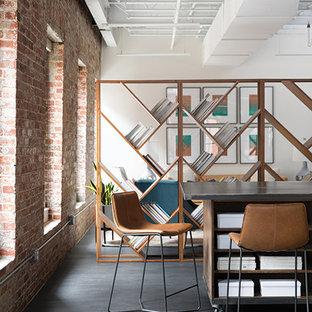 ボストンの広いインダストリアルスタイルのおしゃれな書斎 (マルチカラーの壁、濃色無垢フローリング、暖炉なし、黒い床) の写真