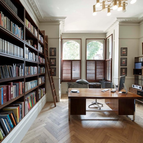 home office flooring. transitional freestanding desk medium tone wood floor and beige home office photo in london with flooring m