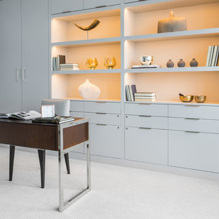 Example of a mid-sized trendy freestanding desk carpeted and beige floor study room design in Philadelphia with gray walls and no fireplace