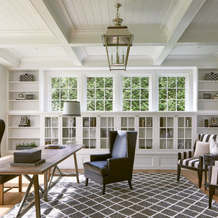 Inspiration for a beach style freestanding desk medium tone wood floor study room remodel in DC Metro with white walls