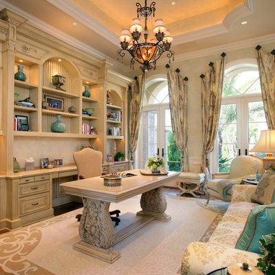 Inspiration for a mid-sized mediterranean freestanding desk dark wood floor and beige floor study room remodel in Miami with white walls and no fireplace