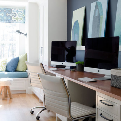 Study room - large transitional built-in desk medium tone wood floor study room idea in Boston with blue walls and no fireplace