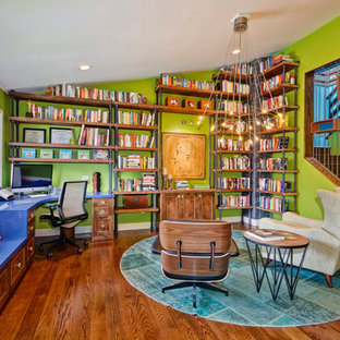 Study room - contemporary built-in desk medium tone wood floor and brown floor study room idea in San Diego with green walls
