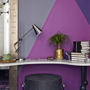 This is an example of a contemporary study in Chicago with purple walls and a freestanding desk.