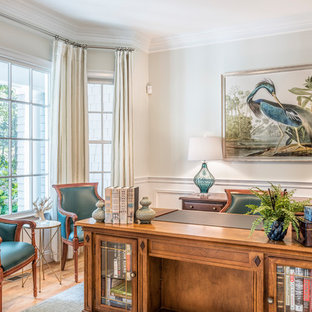 Inspiration for a mid-sized timeless freestanding desk medium tone wood floor and brown floor study room remodel in Boston with gray walls and no fireplace
