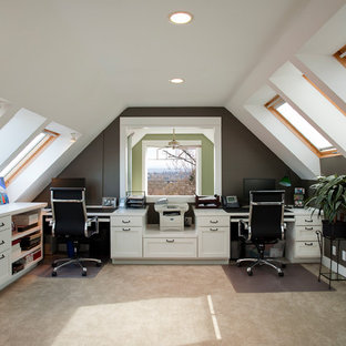 Photo of a large arts and crafts study room in Seattle with white walls, carpet, no fireplace and a built-in desk.