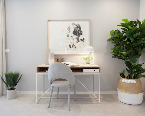 Contemporary Home Office In Melbourne With Grey Walls, A Freestanding Desk  And Beige Floor.