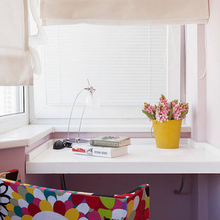 Design ideas for a home office and library in Moscow with purple walls and a built-in desk.