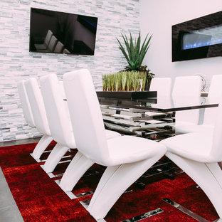 Ejemplo de despacho moderno, grande, con paredes grises, suelo de baldosas de cerámica y chimeneas suspendidas