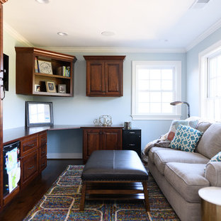 Inspiration for a mid-sized transitional built-in desk dark wood floor and brown floor home office remodel in Other with blue walls and no fireplace