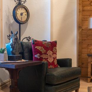 他の地域の中くらいのサンタフェスタイルのおしゃれなホームオフィス・書斎 (黄色い壁、淡色無垢フローリング、標準型暖炉、石材の暖炉まわり、ベージュの床) の写真