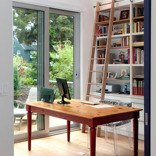 Inspiration for a contemporary freestanding desk light wood floor home office remodel in Vancouver with white walls