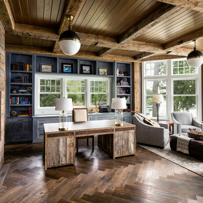Study room - farmhouse freestanding desk dark wood floor study room idea in Milwaukee with gray walls, a wood fireplace surround and a ribbon fireplace