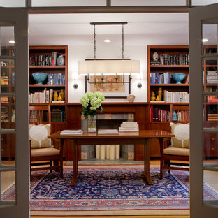 Inspiration for a large transitional freestanding desk medium tone wood floor study room remodel in Miami with white walls, a standard fireplace and a tile fireplace