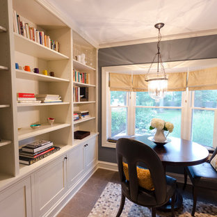 Inspiration for a traditional home office and library in Chicago with limestone flooring and a freestanding desk.