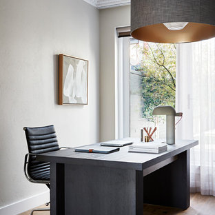 Photo of a contemporary home office in Melbourne.
