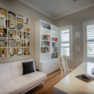 Inspiration for a modern home office remodel in Sydney with gray walls