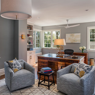 Large classic study in Philadelphia with grey walls, dark hardwood flooring, a freestanding desk, grey floors, a standard fireplace and a metal fireplace surround.