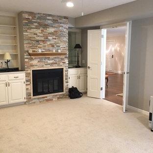 Inspiration pour un bureau design de taille moyenne avec un mur beige, moquette, une cheminée standard et un manteau de cheminée en pierre.