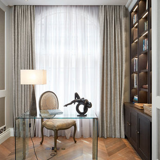 Design ideas for a classic home office and library in London with a reading nook, light hardwood flooring, no fireplace and a freestanding desk.