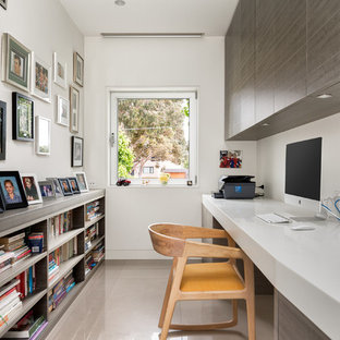 Photo of a contemporary study room in Geelong with white walls, a built-in desk and beige floor.