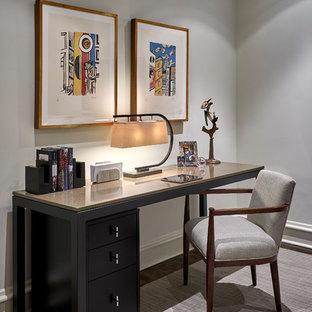 Example of a trendy freestanding desk dark wood floor home office design in Chicago with gray walls