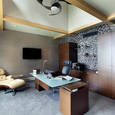Example of a mid-sized trendy freestanding desk carpeted study room design in Grand Rapids with multicolored walls