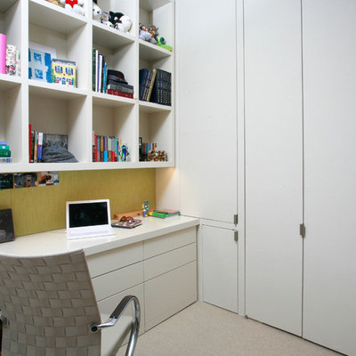 Example of a trendy built-in desk carpeted home office design in New York