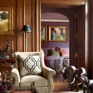 ニューヨークの広いトランジショナルスタイルのおしゃれな書斎 (茶色い壁、濃色無垢フローリング、標準型暖炉、コンクリートの暖炉まわり、茶色い床) の写真