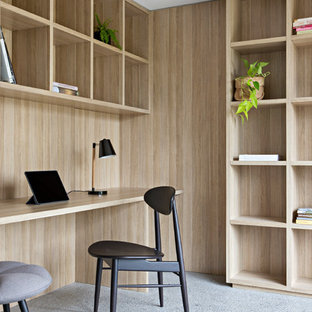 Mid Sized Minimalist Built In Desk Concrete Floor Study Room Photo In  Melbourne With
