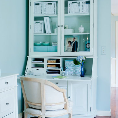 Inspiration for an eclectic home office remodel in Boston with blue walls