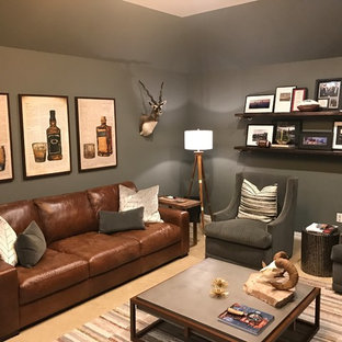 Mid-sized mountain style freestanding desk carpeted and beige floor study room photo in Dallas with gray walls and a hanging fireplace