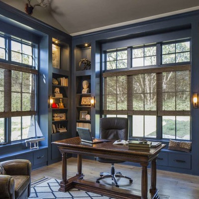 Inspiration for a large transitional freestanding desk brown floor and light wood floor study room remodel in Austin with blue walls and no fireplace