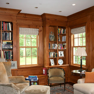 Example of a mid-sized classic dark wood floor and brown floor study room design in New York with no fireplace
