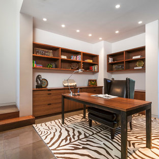 Trendy freestanding desk home office photo in Santa Barbara with white walls
