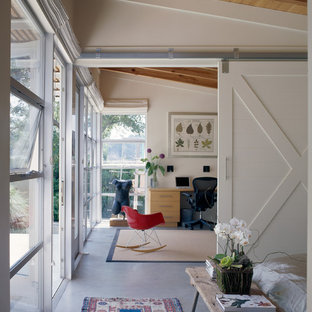 Design ideas for a contemporary home office and library in Santa Barbara with concrete flooring.