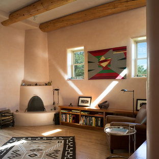 Diseño de despacho de estilo americano con chimenea de esquina