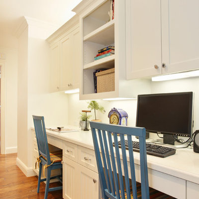 Home office - traditional built-in desk home office idea in San Diego
