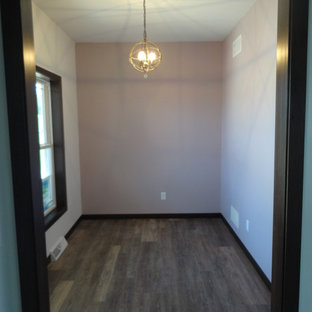 This is an example of a small classic study in Milwaukee with purple walls, vinyl flooring, no fireplace, a freestanding desk and brown floors.