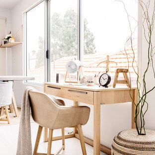 Inspiration for a scandinavian home office in Melbourne with white walls, light hardwood floors and a freestanding desk.